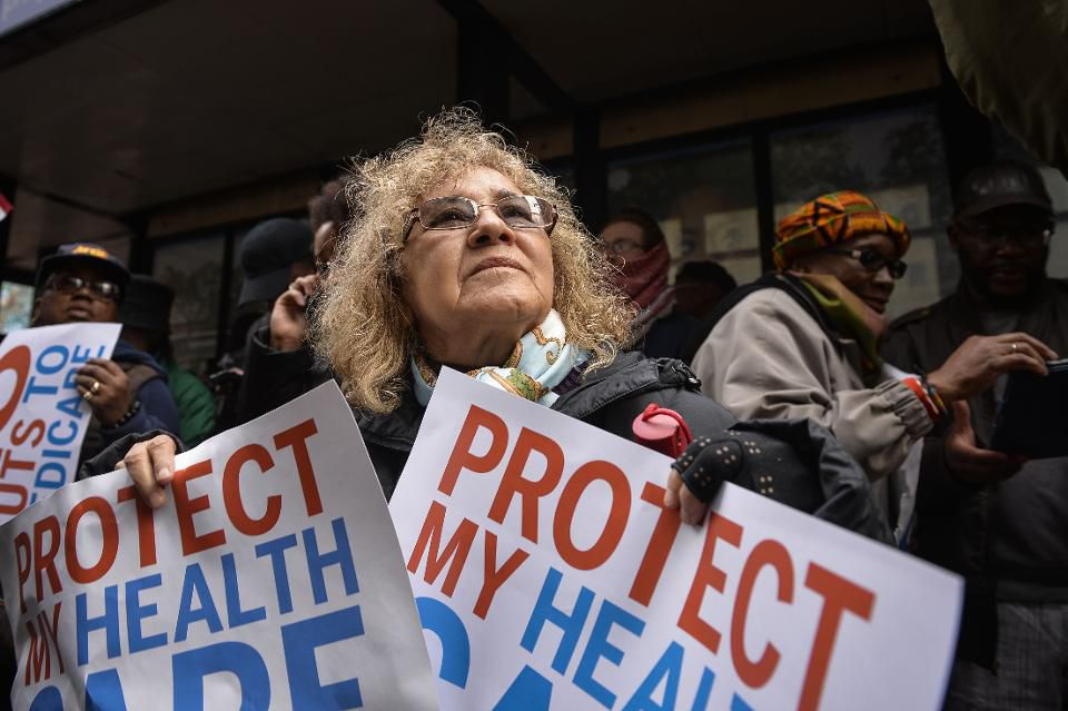 Healthcare demonstrator outside the Republican Party's annual policy retreat in Philadelphia, U.S., Jan. 26, 2017. (Photographer: Charles Mostoller/Bloomberg © 2017 Bloomberg Finance LP)